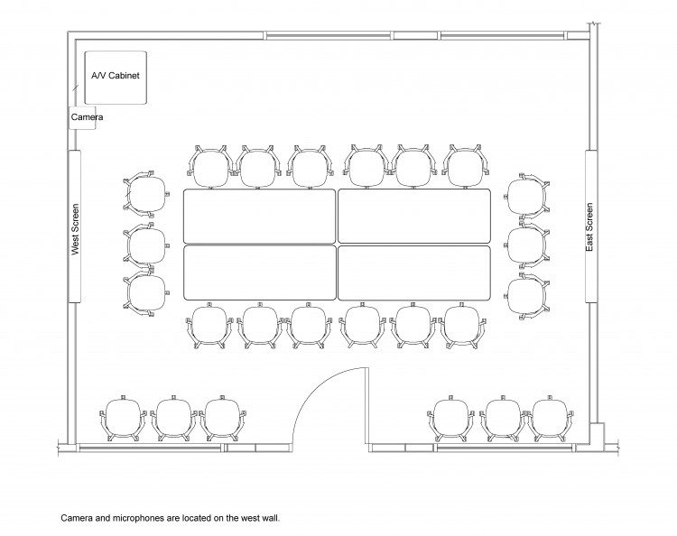 Layout of the room where all of the tables are pushed together to make a large rectangle with 18 chairs around it.
